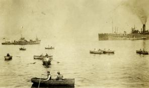 Chaser, wherries, and gasolene barge, Bantry. Betzig Collection.