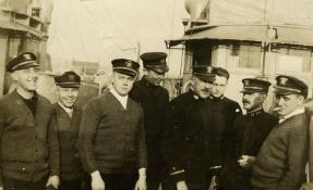 Harry Betzig, CO of SC 181, far left.
