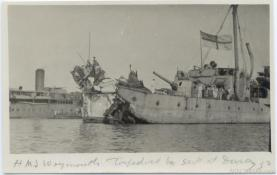HMS Weymouth, torpedoed by a submarine. Shown in Brindisi harbor following the engagement. G.S. Dole Collection.