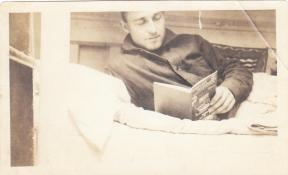 "Crewman on chaser reading ""Wireless Telegraphy"" book"