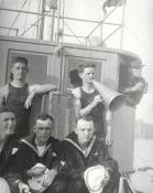 Crewmen forward of the pilot house