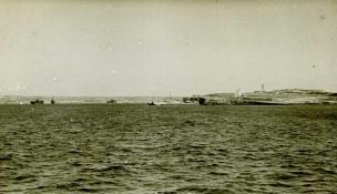 Malta SetChaser skiff, with crewmen in raincoats.