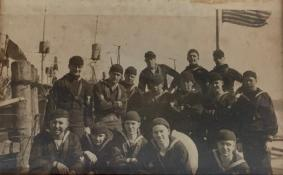 """Henry """"Harry"""" J. Trussell, top row, under the flag."""